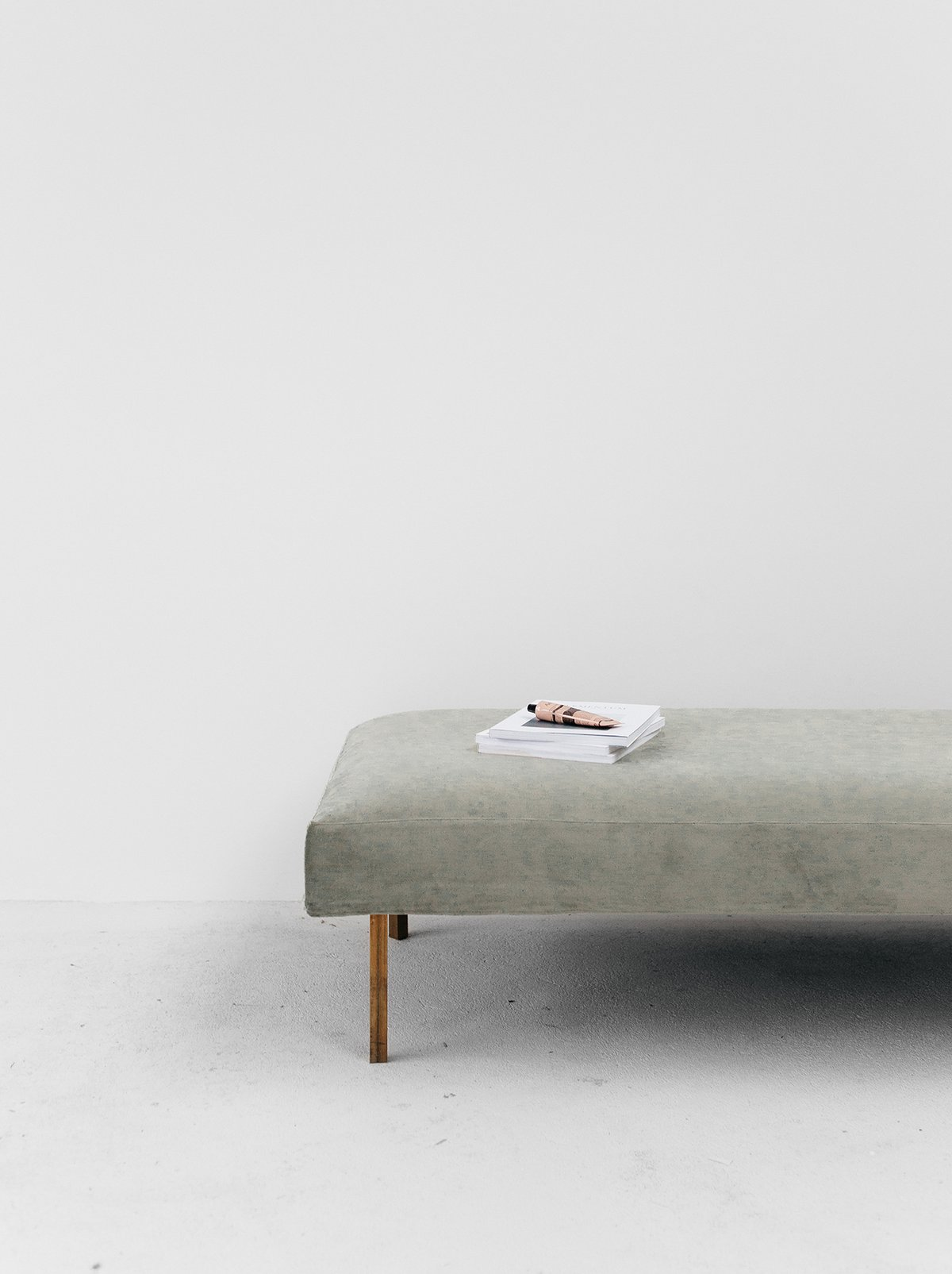 Rye London styled with daybed with brass legs and velvet cover