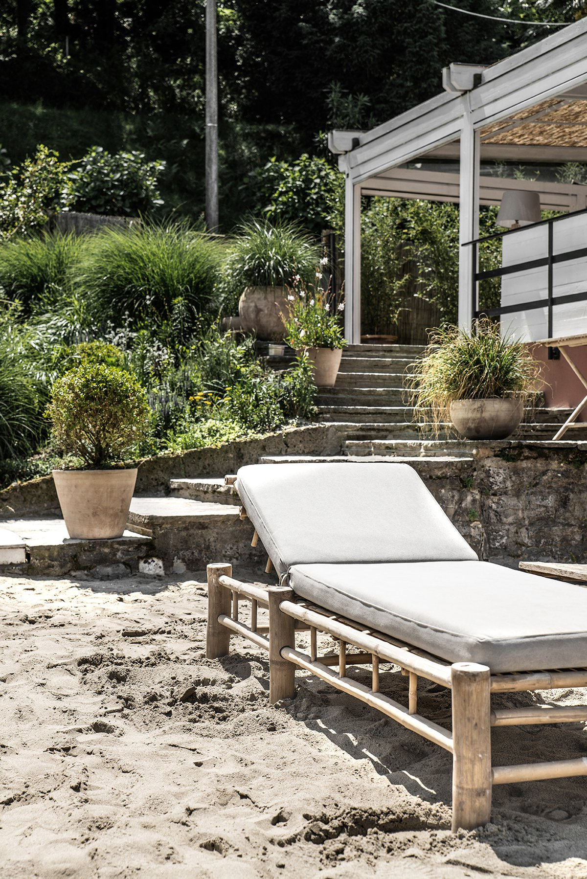 Lido Di Lenno beach bar at Lake Como, Italy decorated with tinekhome bambed with grey cushion