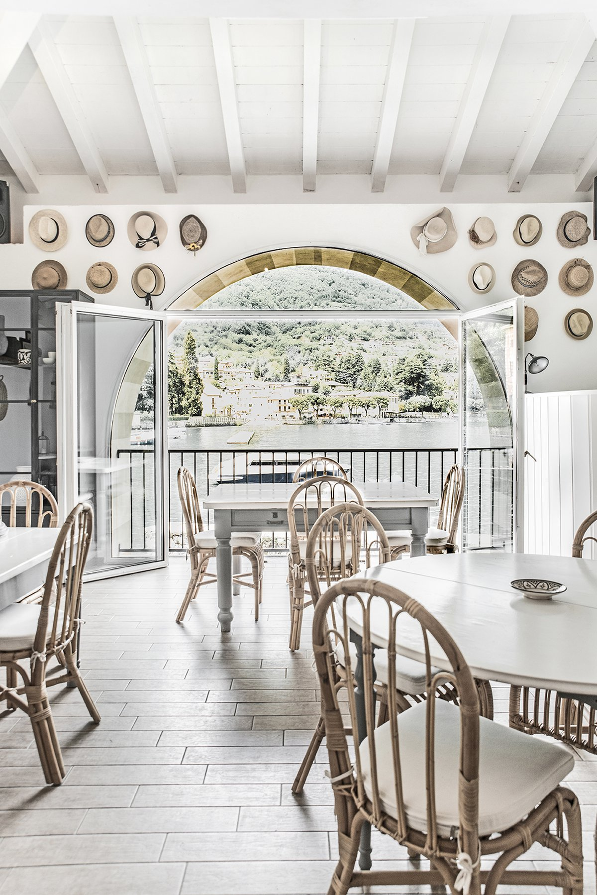 Lido Di Lenno beach bar at Lake Como, Italy decorated with tinekhome rattan furniture, dining chairs