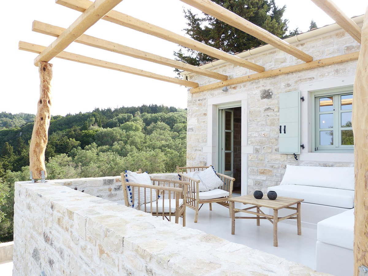 Patroclus rental home in Paxos, Greece. The home is decorated with bamboo dining furniture.