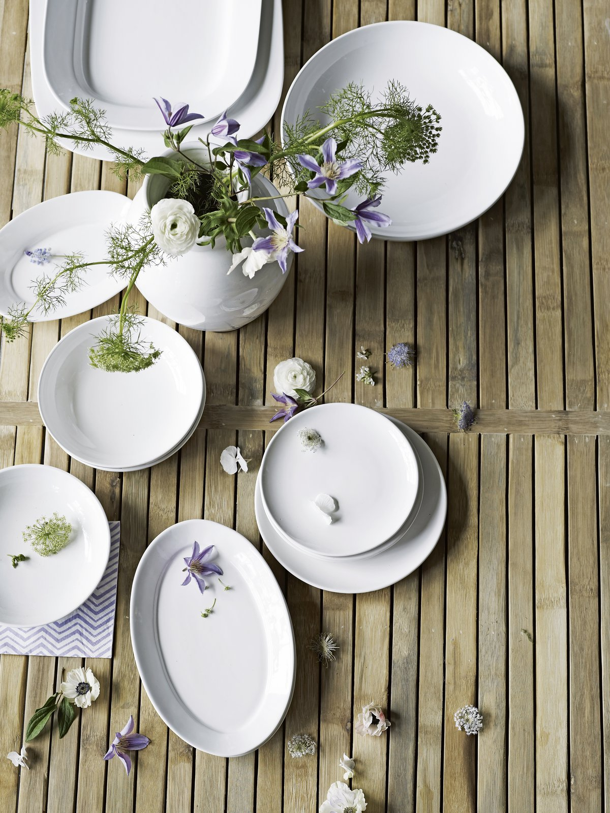 Easter table setting with fresh flowers and white ceramic - bring Spring to your Easter table