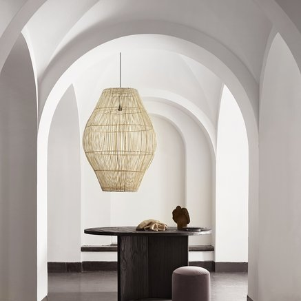Hanging lamp shade in rattan
